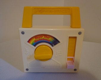 "Vintage Fisher Price ""Over the Rainbow"" Wind Up Toy"