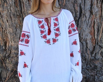 White blouse with red embroidery
