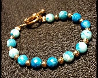 "7 1/2"" Blue Agate and 14K Gold Bead Bracelet"