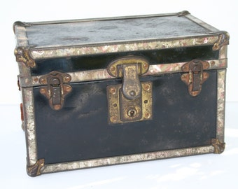 Vintage metal trunk; small rusty trunk; old metal strongbox