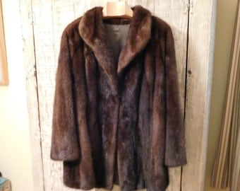 Mink Jacket. Genuine.  Like new.  Rich Mahogany shades.   Demi-shawl color.  Size M/L.