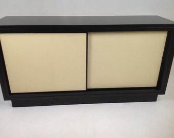 Modern cabinet with leather and walnut finish