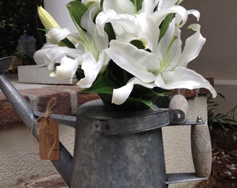Fresh Flowers in Unique Useful Watering Pot
