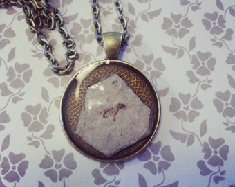 Bee fossil pendant