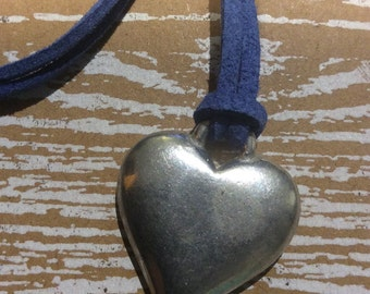 Chunky heart charm necklace on cornflower blue suede