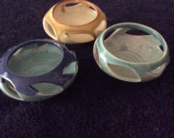 Three votive pottery candle holders