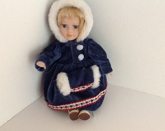 """9 1/2"""" Winter Ready Porcelain Doll with Blue Velvet Hoodie and Muff"""