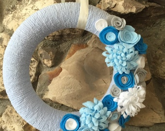Blue, gray and white yarn wreath