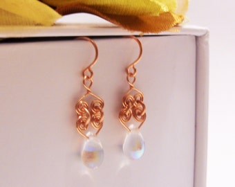 copper earrings with copper wire spirals and crystal teardrop