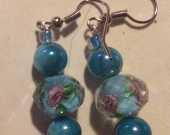 Light teal dangle earrings