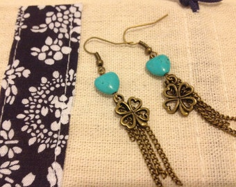 Vintage style earrings with clover leaf and tassels