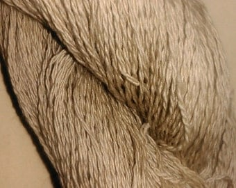 Undyed 2 ply laceweight 90%lambswool, 10 cashmere. 50g