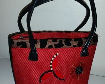 Woven beaded handbag