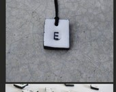 Ceramic letter charm necklace white porcelain with black letter handcrafted in Greece square geometric porcelain necklace