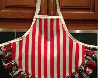 Toddler apron-new to SweetTDresses. Adorable red and white stripes with a retro flower ruffle. Perfect for your little princess!