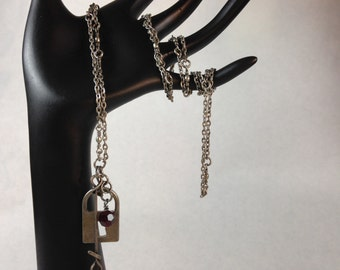 Steampunk necklace with lock, key and crystal.