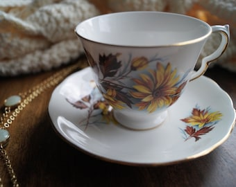 "Queen Anne Teacup and Saucer, Yellow ""Daisy"" Flowers, Brown Leaves"