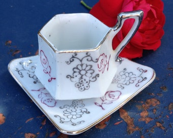 Vintage miniature porcelain cup and saucer