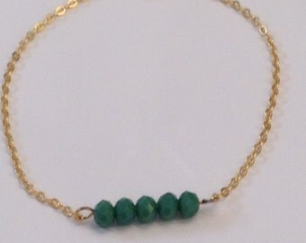 Delicate gold chain bracelet with turquoise bead bar