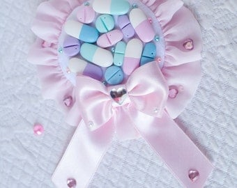Pill rosette brooch / hair accessory