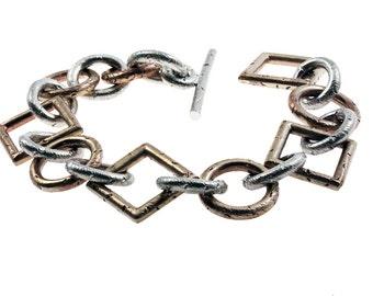 Bracelet bronze et argent à fermoir en T avec mailles ovales  et mailles carrées et rond, bracelet bronze et argent sterling