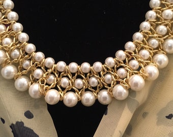 Multi strand pearl and gold necklace
