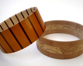 Snare drums and realization in solid wood segments