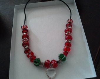 Beautiful necklace with heart pendant and glass beeds