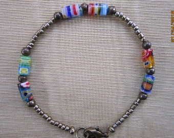 Multi-Colored Bracelet Made With Millefiore Glass Tubes and Antique Gold Beads
