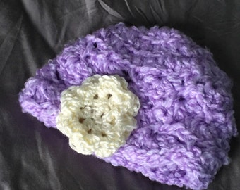 Crochet baby hat with flower