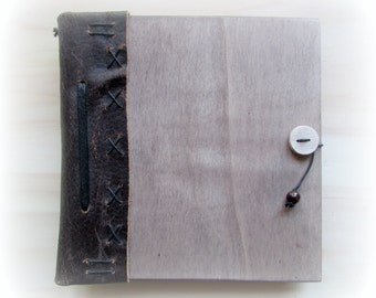 Book of wood bound in leather with zipper