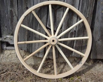"""Wagon Wheels. Highest Quality wooden, decorative wagon wheel on the internet for this price. 42"""" Tall."""