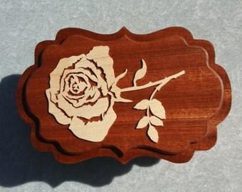 Rose top jewelry storage box.