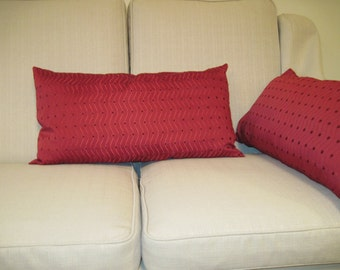A pair of Red textured handmade cushions