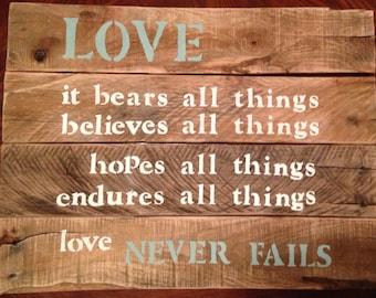 "Pallet sign ""love never fails"""