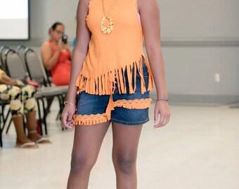 orange fringe top with jean shorts w/orange fringe