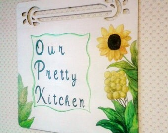 Wooden kitchen plaque, painted in tempera with written and floral motifs.