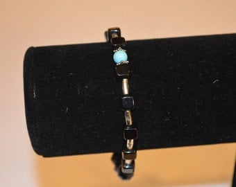 Black with turquoise and silver accents stretch bracelet