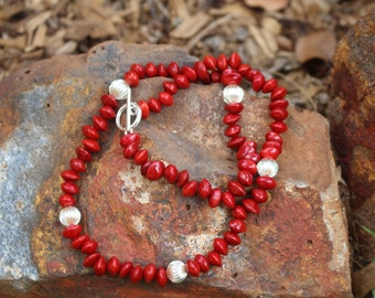 Handmade Red Sandalwood Seed Necklace with silver ridged balls.