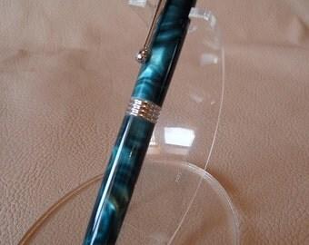A handmade chrome & turquoise streamline pen