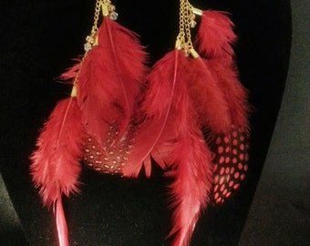 Red and gold feather earrings