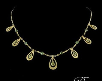 Necklace peridots Emerald yellow gold 18K 1900