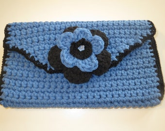 Clutch bag in blue and black with detachable flower brooch