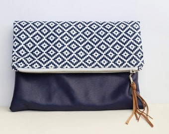 Purple faux-leather foldover clutch