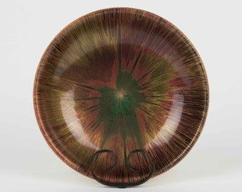 This decorative obeche bowl - 'Black Poppy'  encapsulates an exotic  look which is reflected in the African wood it is made from.