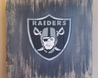Raiders Spray art on wood with mounting hardware on backside. Free Shipping!