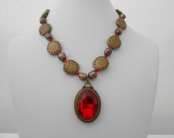 red faceted pendant necklace