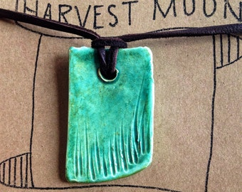turquoise and green ceramic pendant