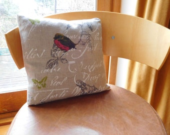 French linen cushion featuring butterflies and birds