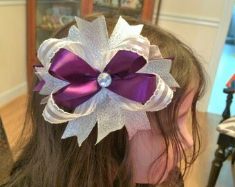 Homemade 5 inch bowtique bow on a French barrette.